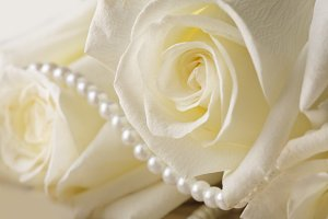 Pearl beads and cream roses