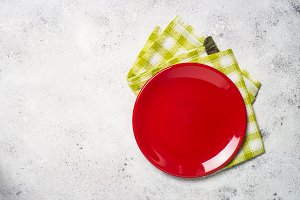 Red plate and tablecloth on light