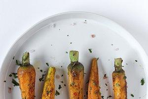 Roasted carrots on white background