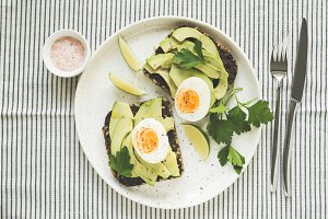 Avocado and egg on rye bread