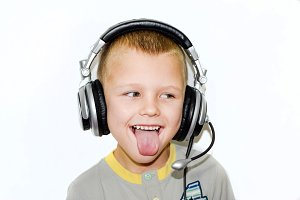 The boy in the music headphones with