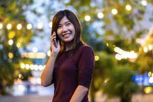 Asian woman using the smart mobile p