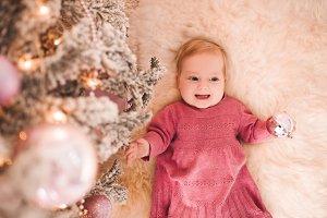 Baby girl under Xmas tree