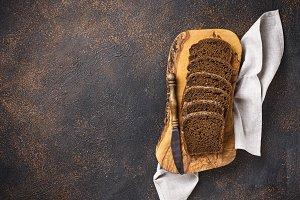 Fresh sliced rye bread on rusty