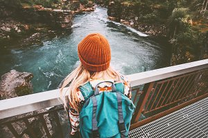 Woman solo traveling with backpack
