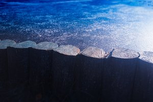 Border of frozen lake background