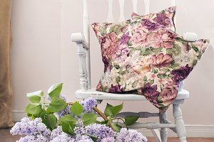 Vintage chair with bouquet of lilac