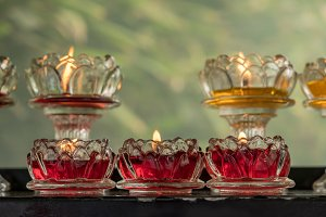 Votive candles in glass dishes at
