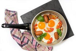 Breakfast scrambled eggs. Frying.