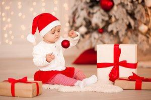Baby with Christmas ball