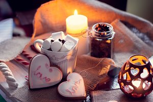 Candles and cup of coffee