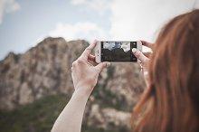 Woman Taking Photo on iPhone