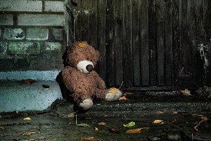Sad wet plush bear