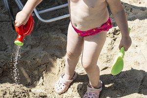 Little girl play on the beach