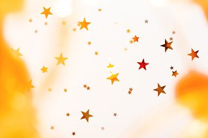 Holiday background with golden stars