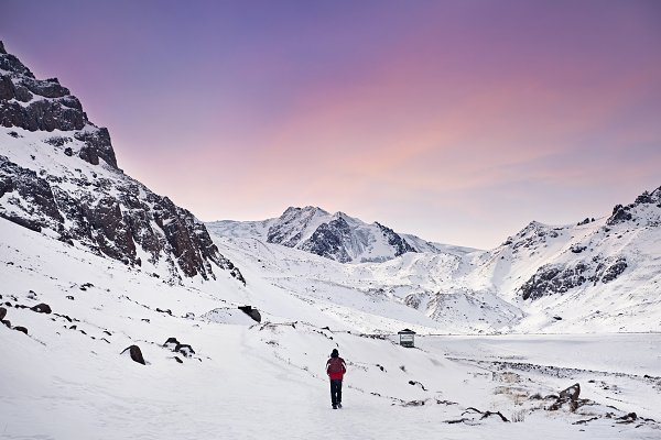 Stock Photos: Pikoso Photography - Hiker in snowy mountains