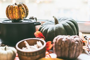 Autumn kitchen with pot and pumpkins