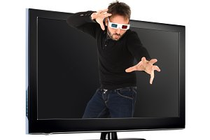 Man Wearing 3d Glasses out of the tv