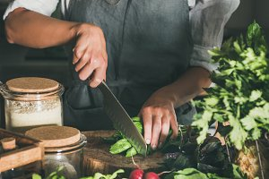 Woman cutting green vegetable