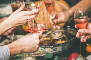 Friends clinking glasses at festive