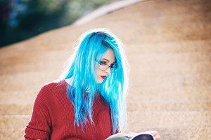 Cute grunge (rock) girl reading book