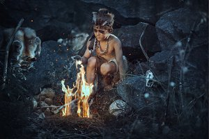 Shamans boy at the fire