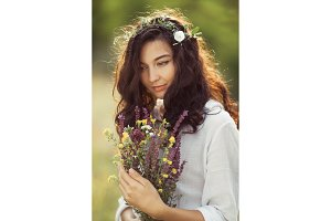 Natural beauty girl with bouquet of