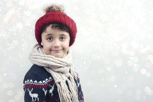 smiling boy with scarf and hat