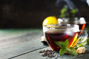Hot tea cup with mint and sugar