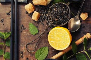 Cups of tea, lemon, ginger and mint