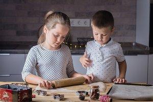 Children preparing  christmascookies