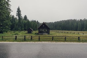 Cottage on the meadow in rain