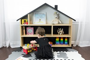 Baby and Dollhouse Shelf With Toys
