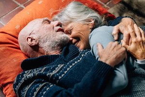 Senior couple lying on floor