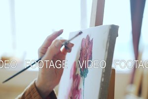 Creative young girl is painting