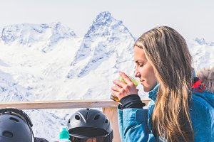 Girl drinks tea mountain summit.