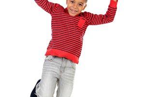 Happy latin child jumping