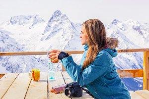 Girl traveler drinks tea.