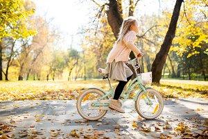 Photo of girl in skirt riding bike