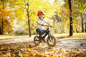 Image of boy in helmet on running