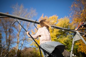 Photo of girl swinging in autumn