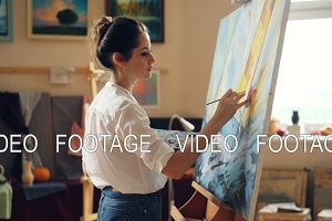 Pretty woman painter is depicting