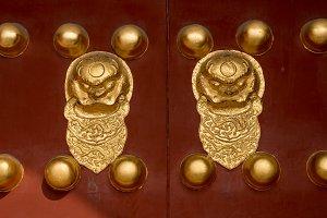 Lion knockers on doors of Forbidden