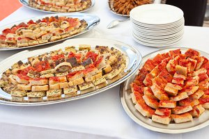Trays with pieces of tomato pizza, o