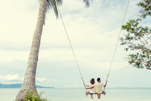 Young couple  on a swing