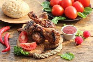 Grilled chicken legs on cutting boar