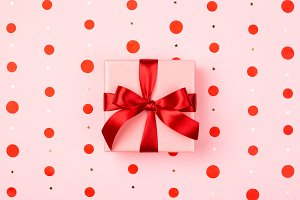 Pink gift box with red bow