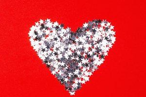 Heart made of silver confetti