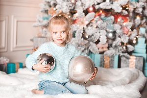 Girl with Christmas balls