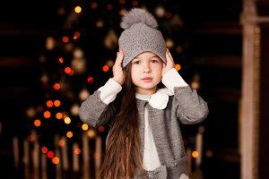 Girl over Christmas lights